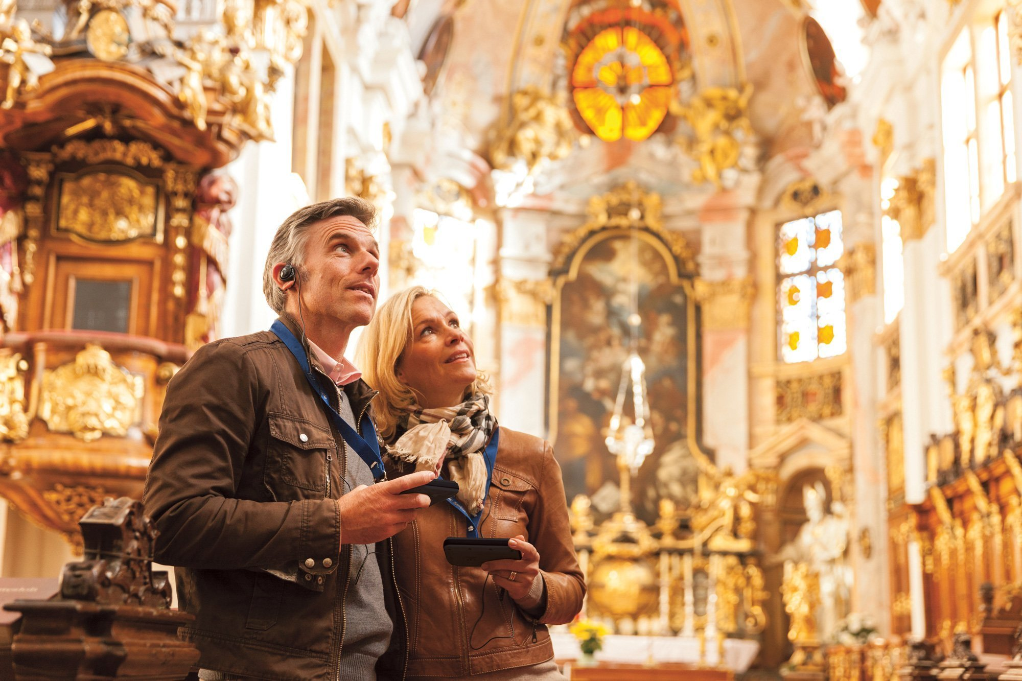 Middle-aged couple doing a tour inside a church